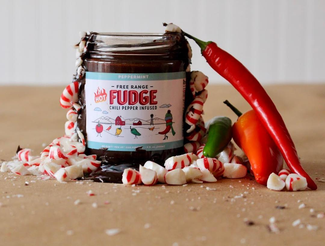 Spicy hot fudge in a jar with peppers and peppermint