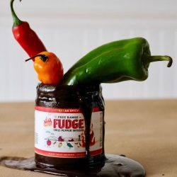 spicy hot fudge in a jar with pepper